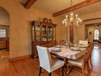 Gather around the formal dining table beneath the chandelier for larger meals.