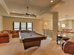 Wander upstairs to play pool or relax on the large sectional in the loft area.