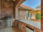 The patio is complete with a full kitchen, ceiling fans, a fireplace and cable TV with speakers.