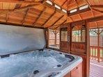 The gazebo houses a 6-person 96 Jet hot tub.
