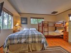 The sleeping area includes a queen-sized bed and a twin-over-twin bunk bed.
