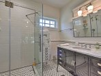 The pristine bathroom includes a walk-in shower.