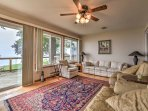 Kick your feet up and read a book in the sunroom with views of the lake.