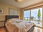 The master bedroom offers a queen bed and access to the deck.
