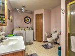 There are 2 bathrooms in the home. This bathroom also features laundry machines for your convenience.