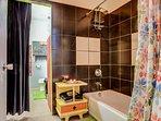 The full bathroom boasts a shower/tub combo.
