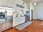 The fully equipped kitchen features stainless steel appliances for your convenience.