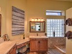 The en-suite master bathroom includes a double vanity-sink and extended walk-in shower.