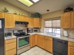 The kitchen includes all the necessary appliances to create a home-cooked meal.