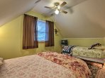 This bedroom offers a full-sized bed as a well as a twin bed for guests to sleep in.