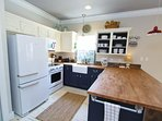 Kitchen has Butcher Block Countertops