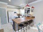 Four Bar Stools at Kitchen Counter