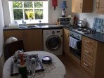 Generous naturally lit kitchen diner, well fitted with washer dryer microwave, and views of garden