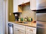 Full kitchen includes mini dishwasher