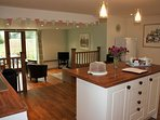 An open plan kitchen & sitting room, perfect for socialising or keeping an eye on the children
