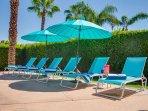 Shade umbrellas dot the pool area