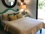 Queen Bedroom with glass sliders to balcony and En-Suite Bath.