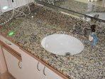 Second bath granite countertop and hair dryer