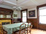 Dining room with ornamental parquet and Victorian detailing seats up to eight for dinner