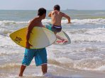 Skim Boarding in the surf is a fun challenge for all.