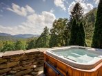 Relax in the hot tub at The Lodge looking out towards Bearwallow Mountain.