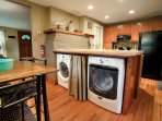 Dining area and kitchen with washer & dryer.
