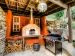 Wood burning pizza oven and a gas BBQ for some very tasty meals.