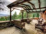 The spacious stone patio with a hot tub and incredible views.