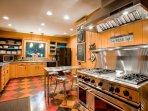 Fully stocked gourmet kitchen.