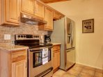 This home features top-notch stainless steel appliances and granite counters.