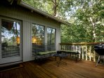 Relax on a private deck while grilling and enjoying the surrounding nature.