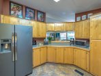 The kitchen is well equipped with updated appliances, ample counter space, and all the culinary tools you need for a...