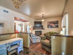 Get last-minute work done in the office area or watch a movie on the cable TV in the living area with gas fireplace.