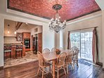 Wine and dine at the formal 8-person dining table beneath the gorgeous chandelier.
