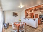 Enjoy snacks and meals in the breakfast nook with a 4-person table, gas stove and a cable TV.