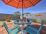 Featuring a fenced-in backyard with a lovely patio set, this home guarantees a relaxing retreat!