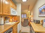 The living room flows into the kitchenette area.