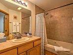 The full bathroom has a shower/tub combo.