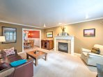 Catch up with loved ones by the gas-burning fireplace in the family room which features a leather couch and leather...