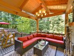 Breathe in the fresh Washington air while you enjoy family time in the outdoor covered living room with a rattan...