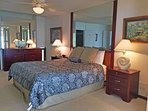 The master bedroom is furnished with a king-sized bed.