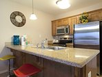 The spacious Granite Counter Tops make for easy meal preparation.