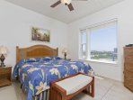 The first of 2 bedrooms offers a King Size rest along with the view.