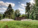 The Carriage House roof in front of those amazingly large boulders!