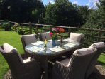 Relax in the enclosed garden with access to the woodland