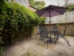 Secure sunny courtyard garden, for alfresco dinning.