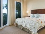 King sized bed in the bright and airy master bedroom