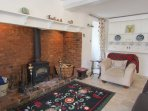Large inglenook fireplace with wood burner