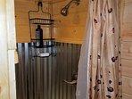 Awesome custom made Tiny House shower with soap and shampoo