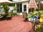 Our courtyard in from of our beautiful vacation home! Delightful decor and landscaping